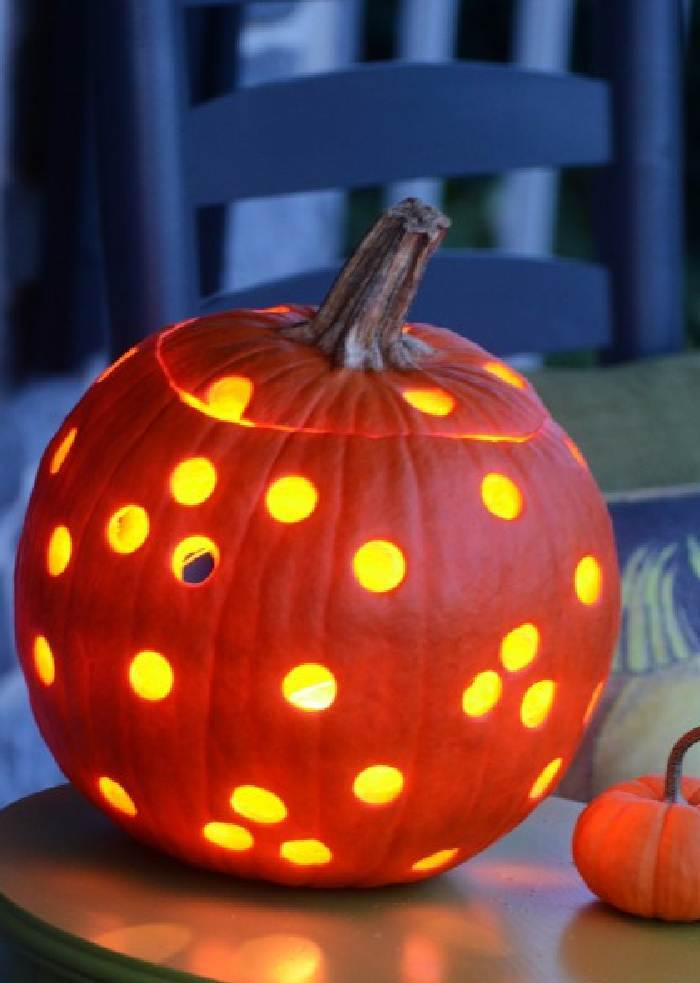 jack- o - lantern with lots of holes