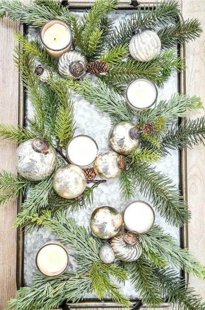 VOTIVE CANDLES ON A TRAY WITH GREENS AND ORNAMENTS