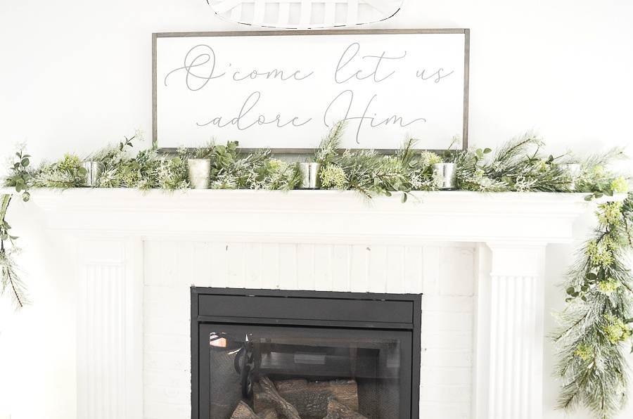 CHRISTMAS MANTEL WITH GREENS AND VOTIVES