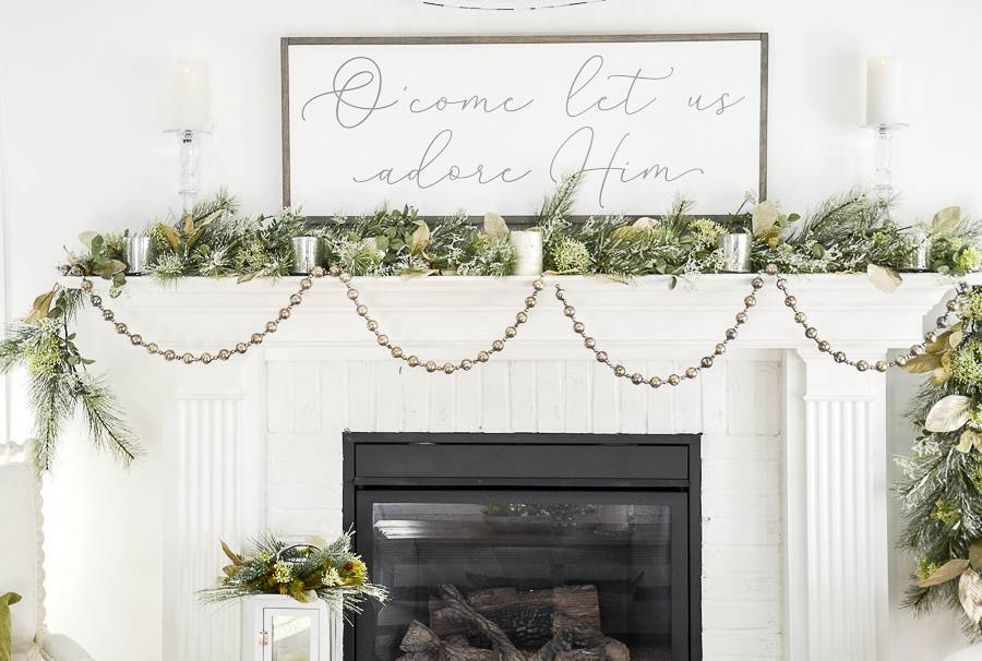 "BEAUTIFUL CHRISTMAS MANTEL WITH SIGN ""O COME LET US ADORE HIM ABOVE IT"