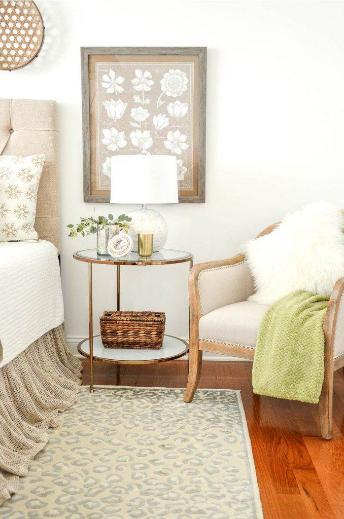A NIGHTSTAND AND A CHAIR WITH A MONGOLIAN THROW