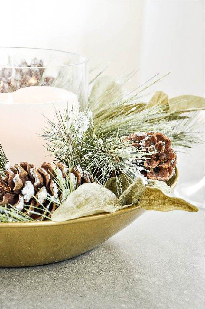 BOWL WITH A CHRISTMAS ARRANGEMENT IN IT