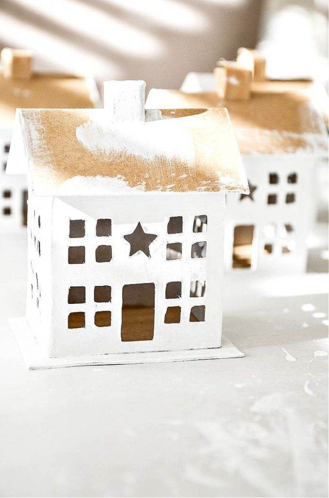 CARDBOARD HOUSES WITH A WHITE COAT OF PAINT ON THEM