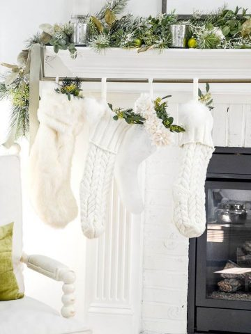 CHRISTMAS STOCKINGS HANGING ON A MANTEL