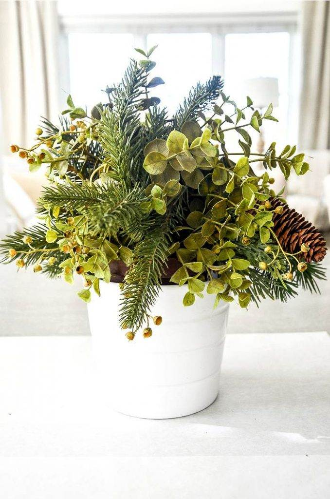 FAUX HOUSEPLANT WITH EVERGREENS STUCK IN THEM