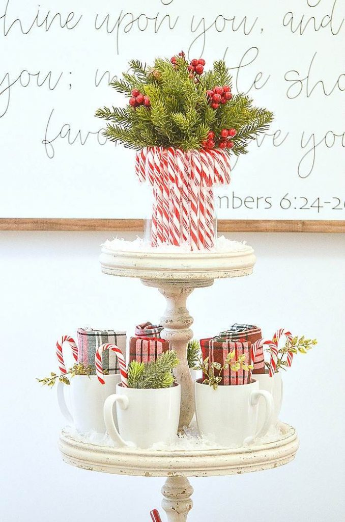 candy canes on a hot chocolate bar