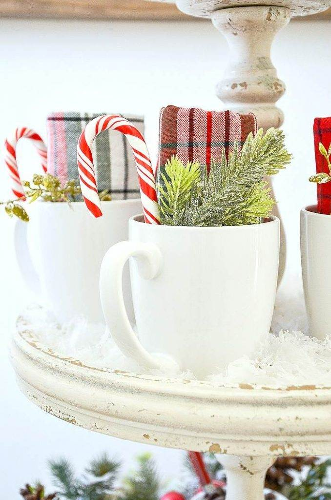 mugs with plaid napkins and candy canes in the