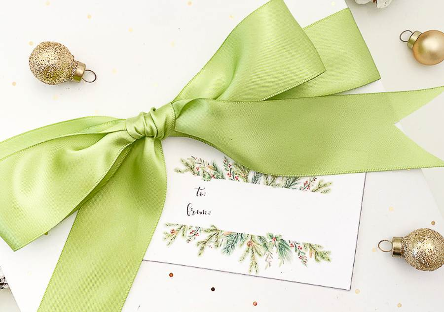 GIFT TAG ON A GIFT WITH A BIG BOW