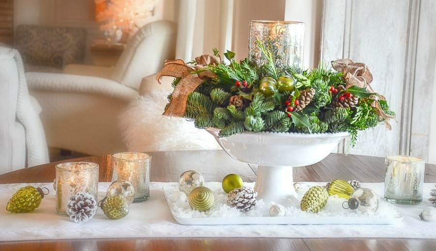 WREATH IN A PEDESTAL BOWL ON A TABLE
