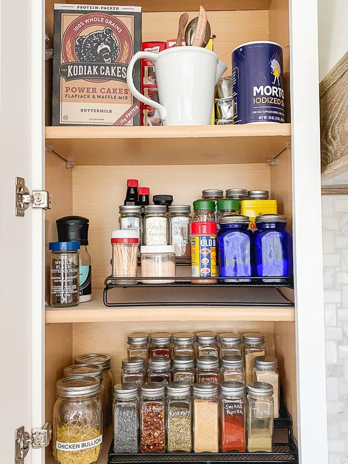 CUPBOARD WITH ORGANIZED SPICES