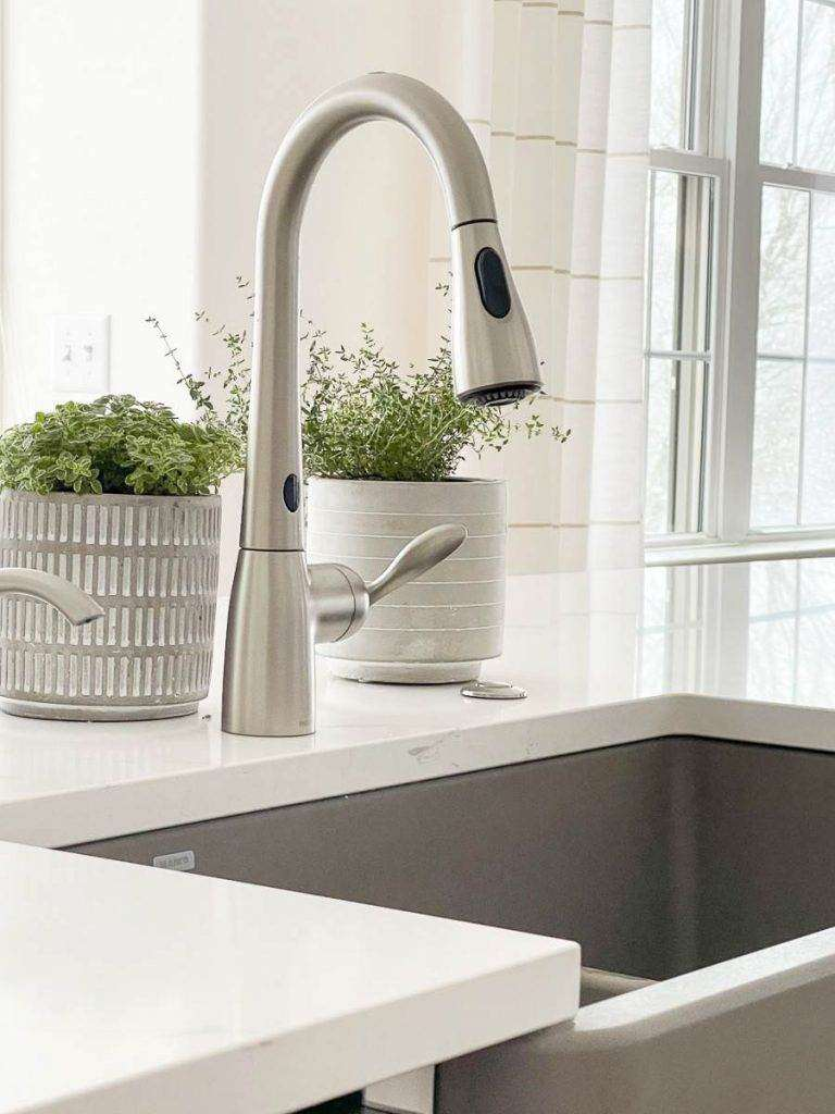 SINK AND FAUCET IN NEWLY MADEOVER KITCHEN