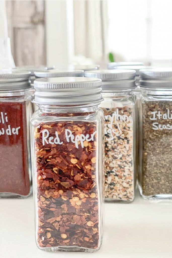IMAGE OF SPICES IN UNIFORM GLASS JARS