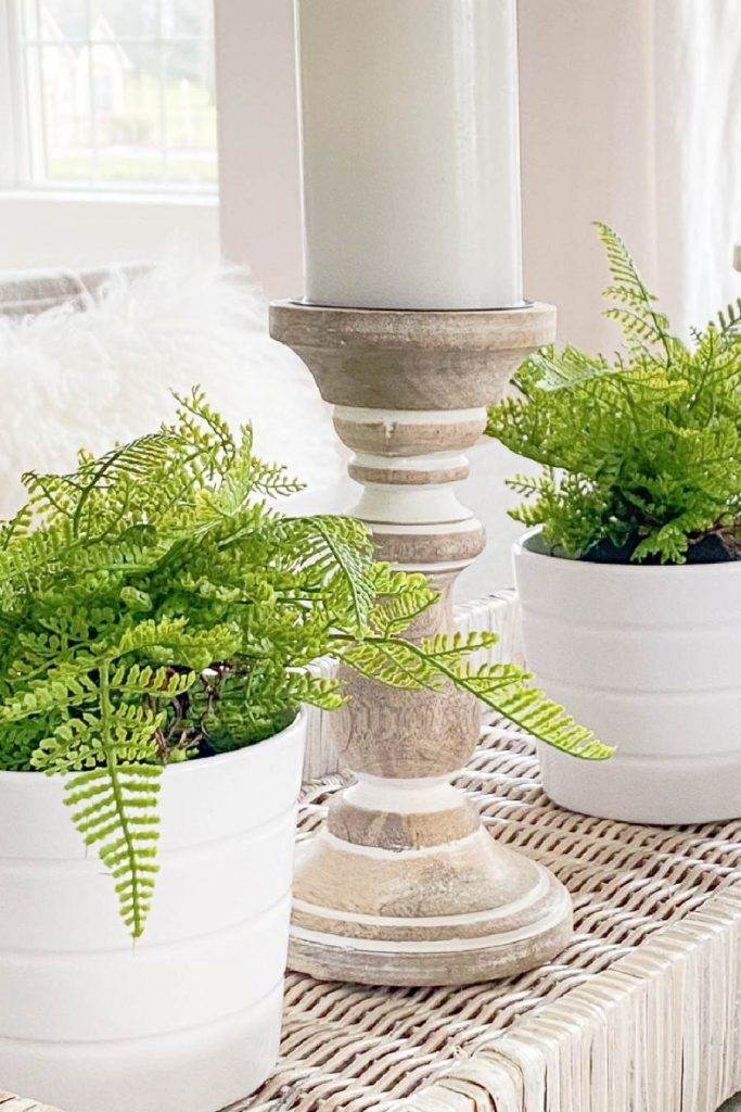 WINTER CENTERPIECE WITH FERNS, CANDLES IN A BASKET