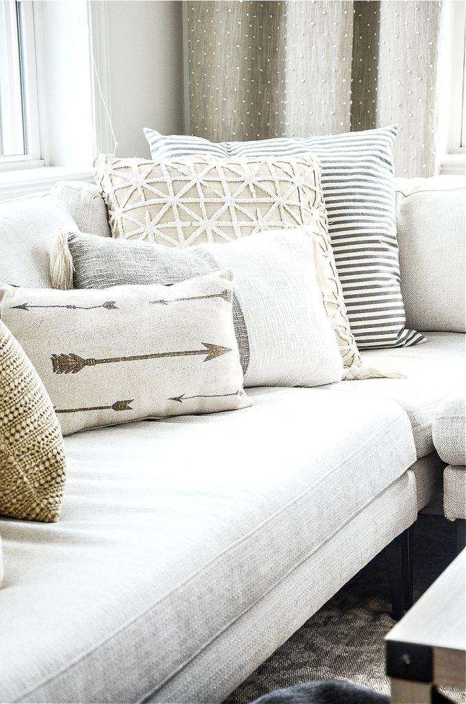 COOL AND WARM UNDERTONE PILLOWS ON A SECTIONAL