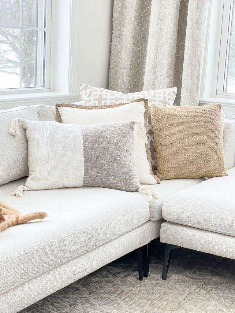 PILLOWS ARRANGED IN THE ELBOW OF A SECTIONAL