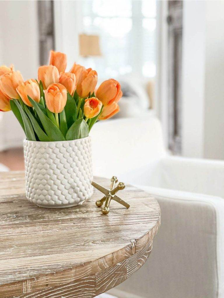 ORGANGE TULIPS ON A TABLE