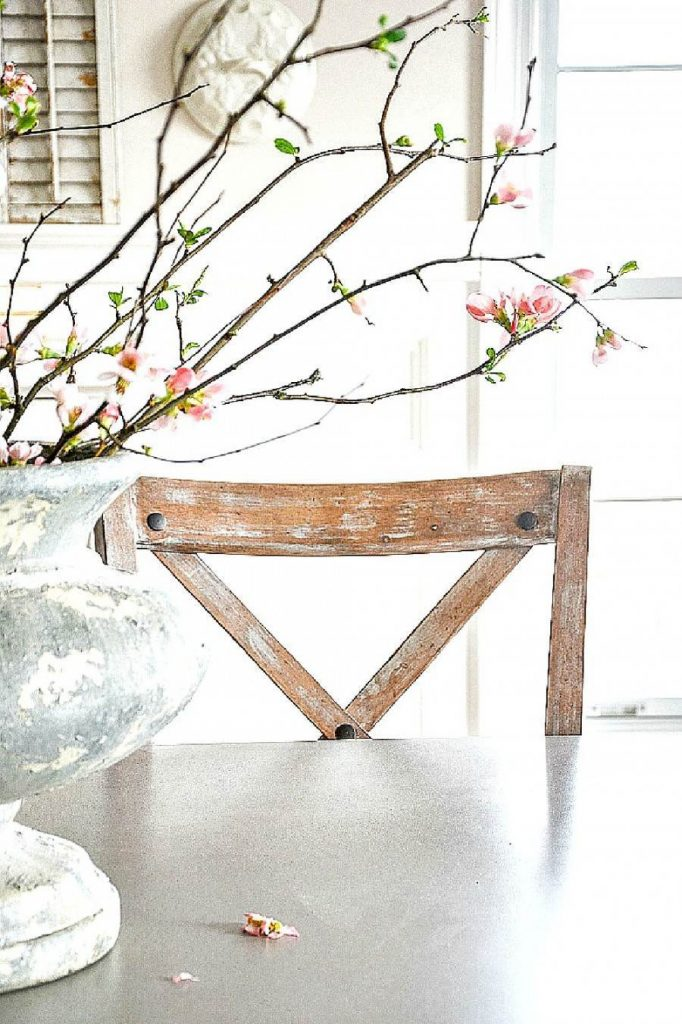 BEAUTIFUL FLOWERING QUINCE BRANCHES ON A TABLE