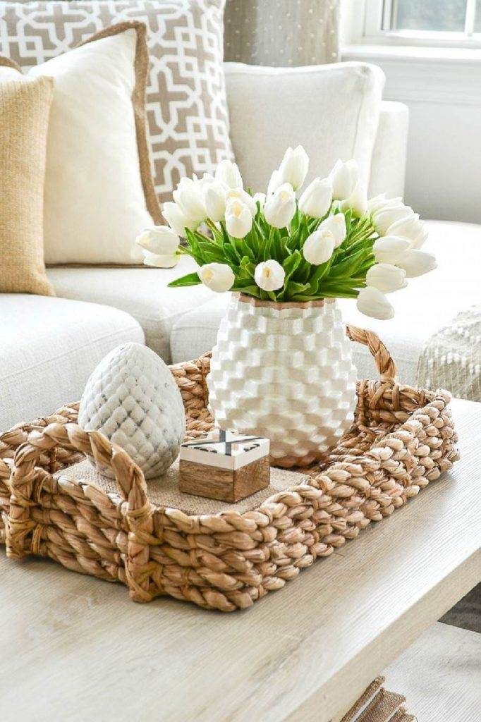 VIGNETTE ON A COFFEE TABLE IN A SMALL ROOM