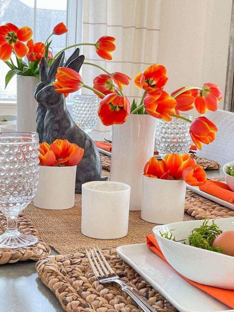 ASSORTED ORANGE TULIPS ON A TABLE
