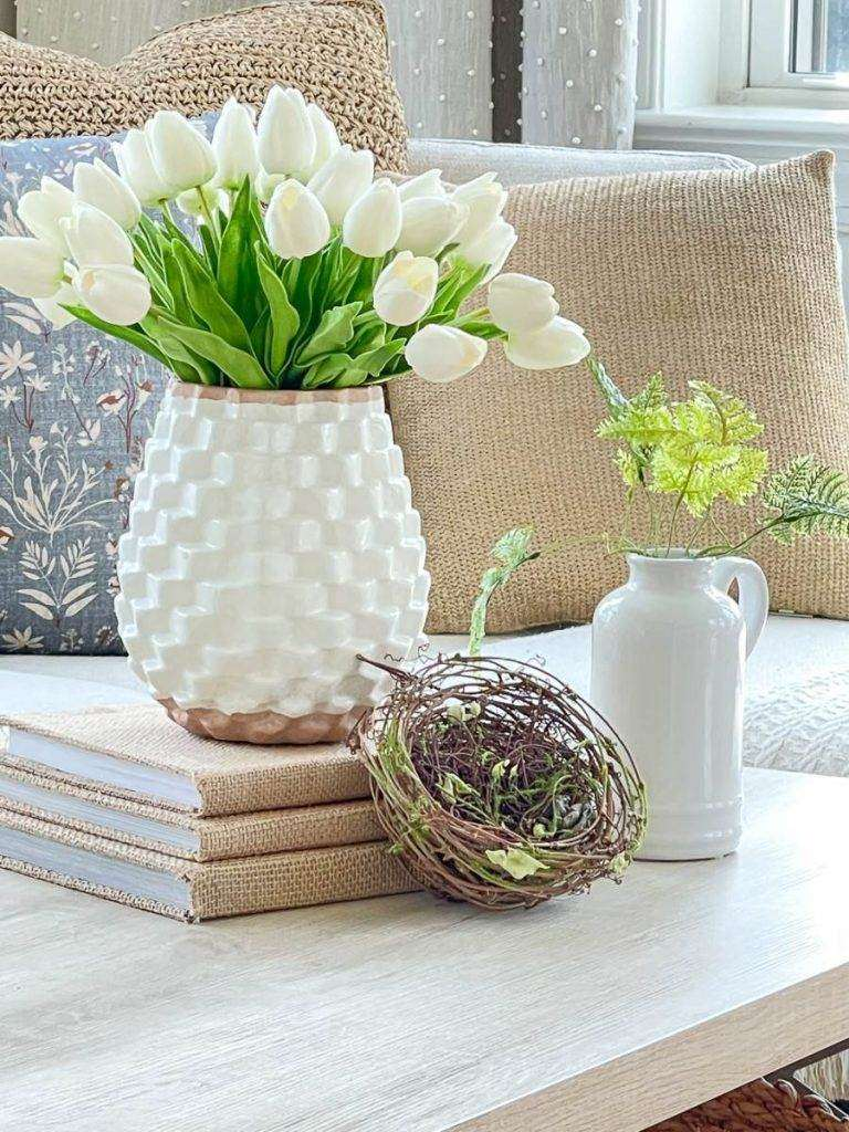 tulips and a nest displayed on a coffee table