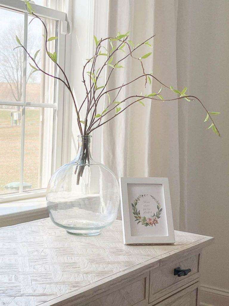 JUG WITH SPRING BRANCHES IN IT