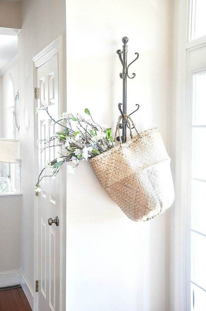 BASKET HANGING ON A LIGHT COLORED WALL