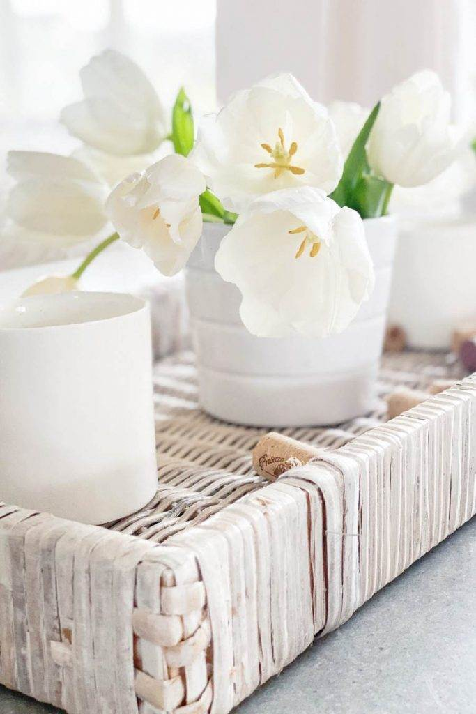 CLOSE UP OF TULIPS ON A DINING ROOM TABLE