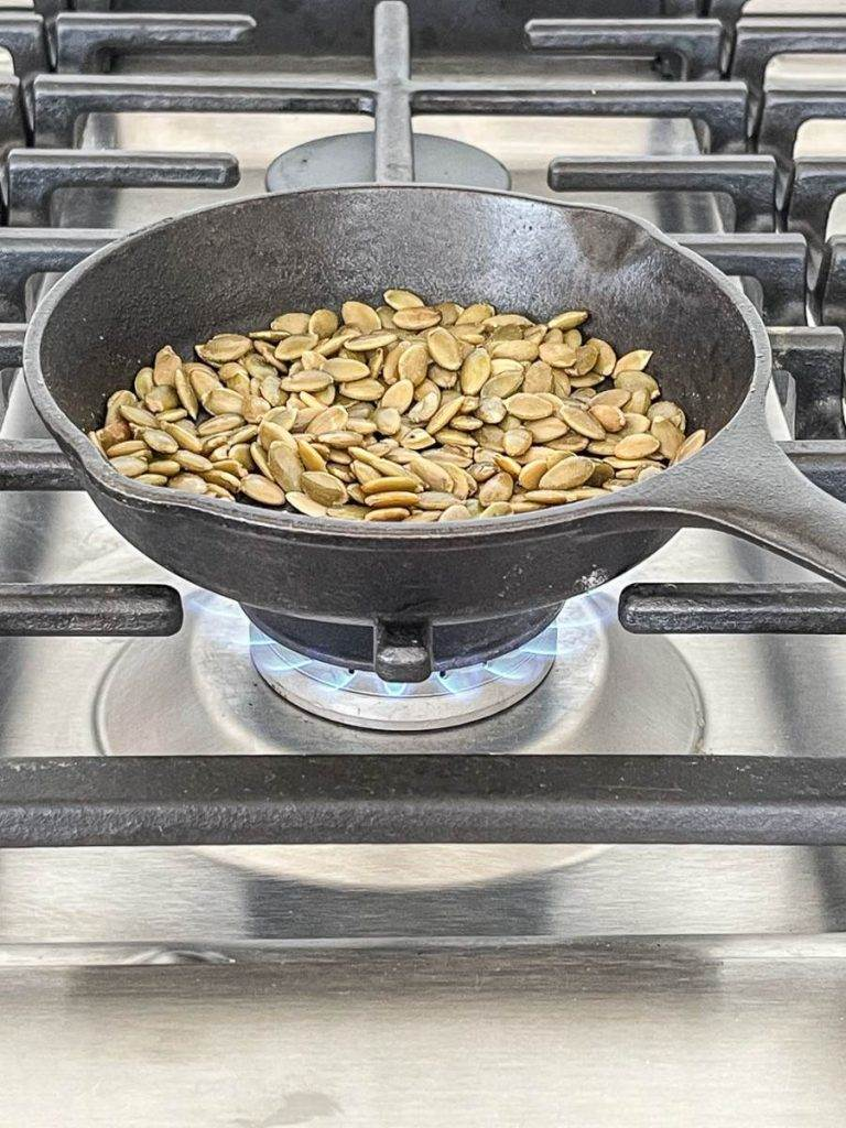 PEPITALS IN A PAN ON THE STOVE
