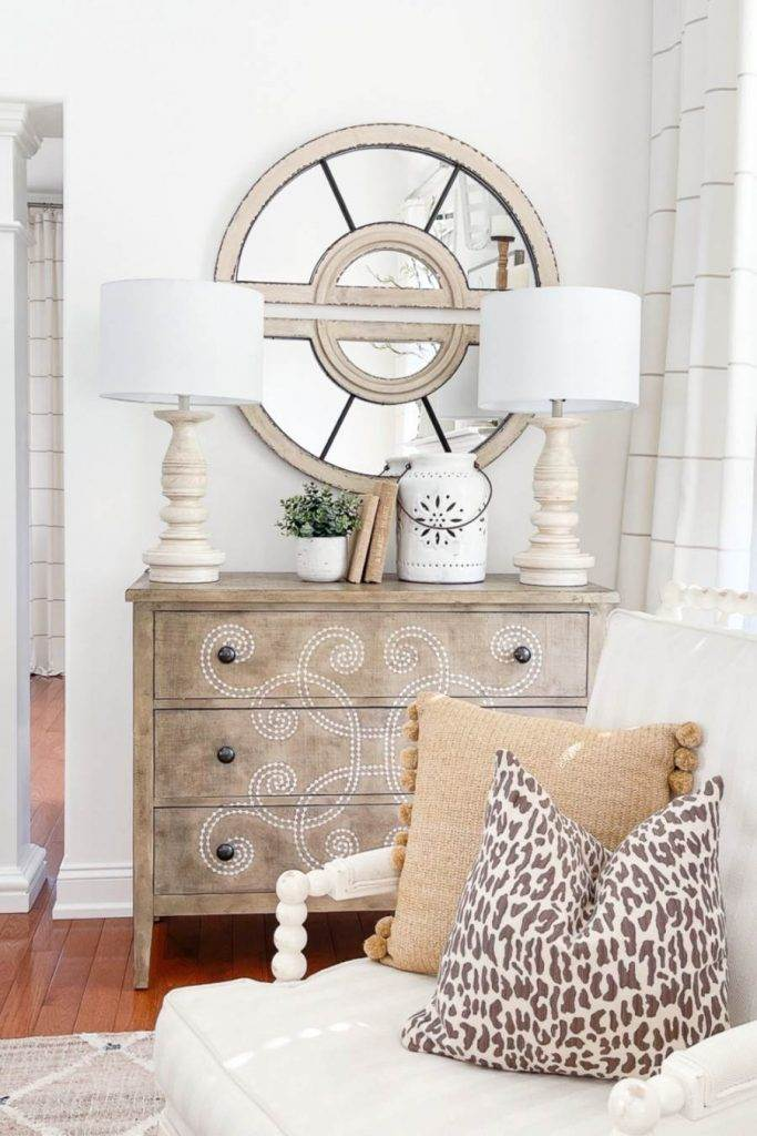 pretty spring display on top of a chest in a living room