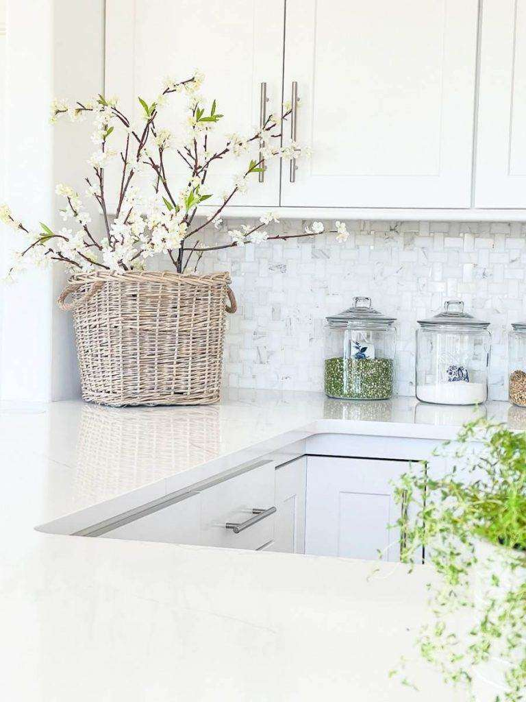 BASKET OF BRANCHES IN AN ORGANIZED KITCHEN