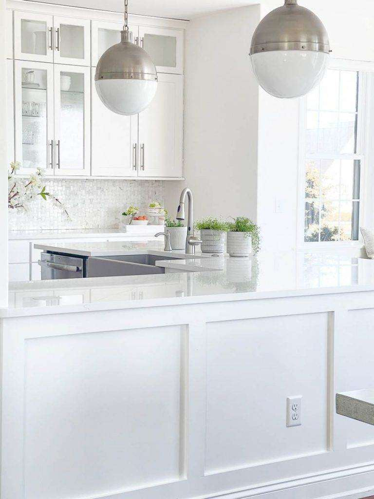 A white kitchen with a mushroom colored sink
