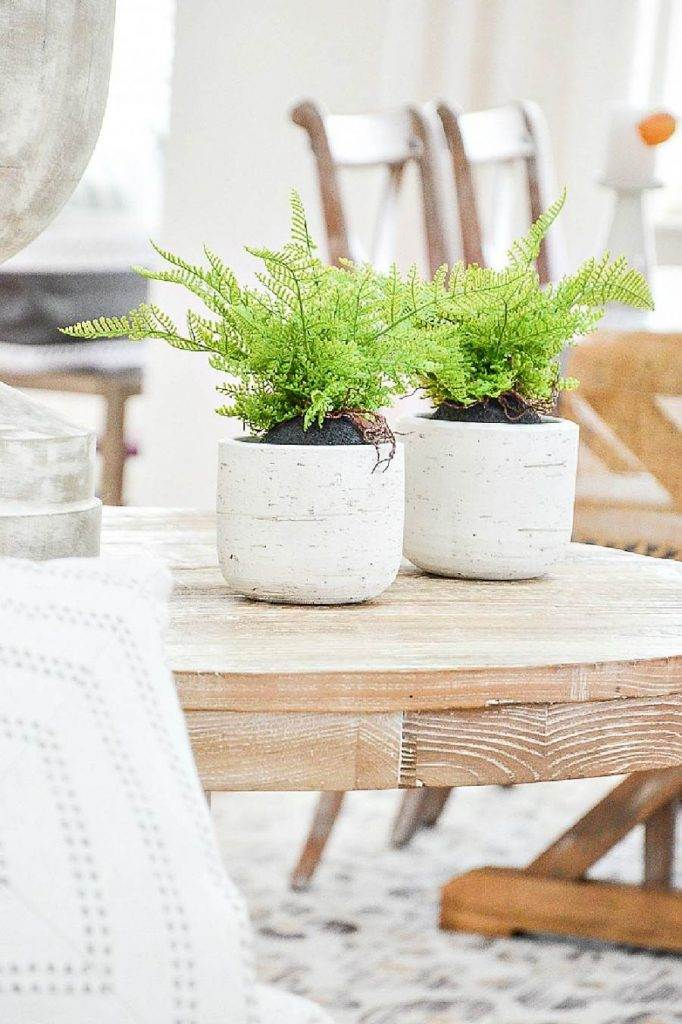 FAUX PLANTS ON A TABLE