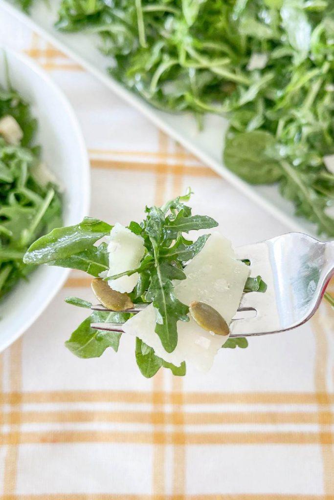 a bite of salad on a fork