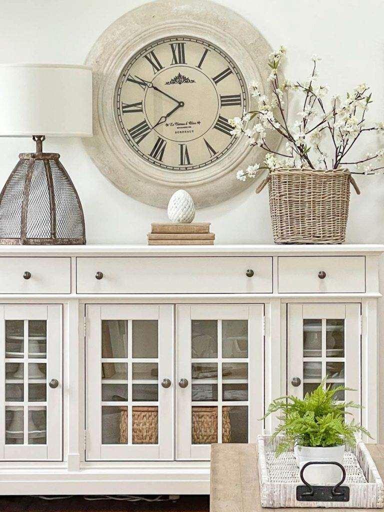 clock above a white buffet