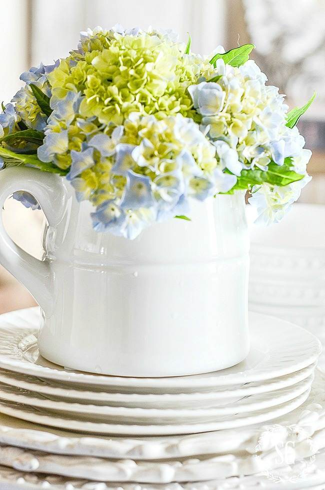 EASY DECORATING IDEAS- STACKING DISHES AS A RISER
