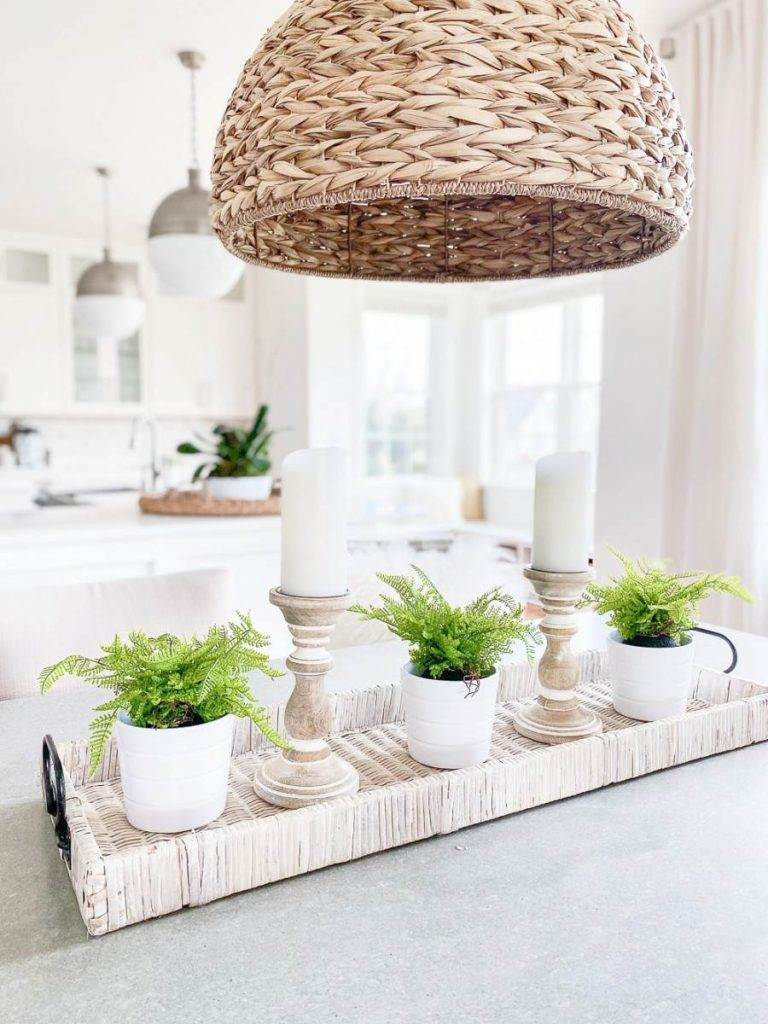 FERNS AND CANDLES ON A TABLE