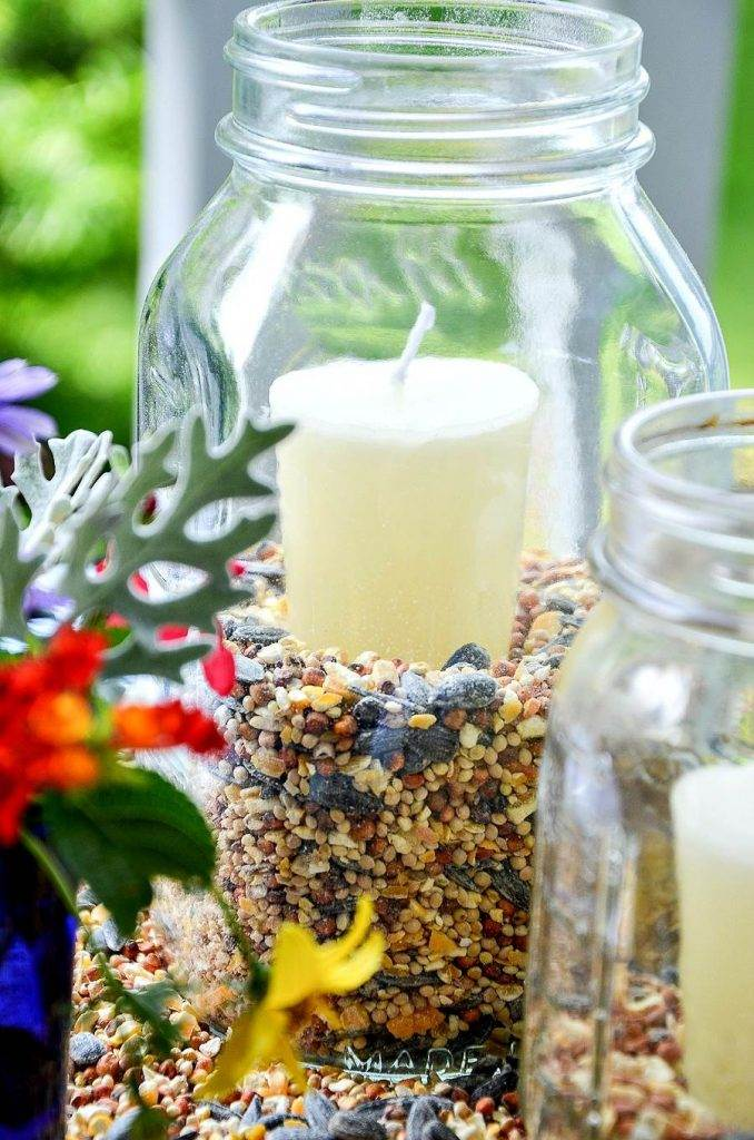 BIRDSEED IN A MASON JAR WITH A CANDLE