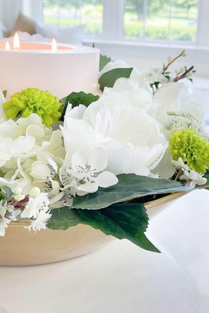 PRETTY FAUX FLOWERS IN AN ARrANGEMENT