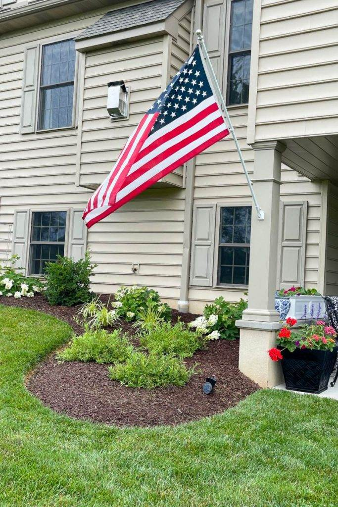 AMERICAN FLAG ON THE BACK OF A HOUSE