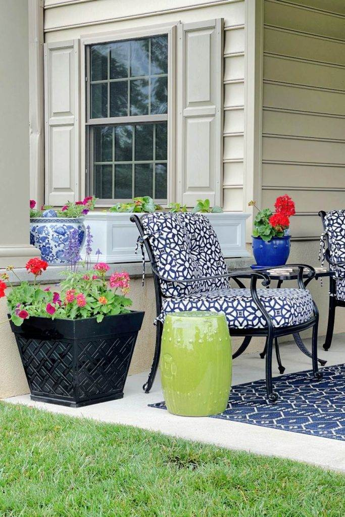 FLOWERS ON A PATIO IN BIG POST AND PLANTERS