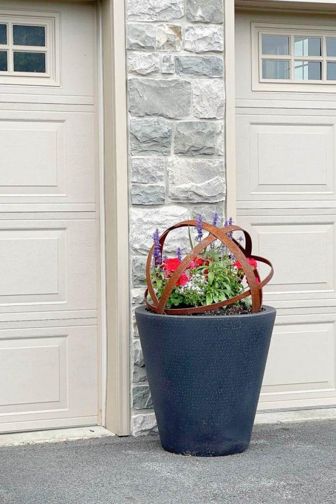 PLANTER OF SUMMER FLOWERS BETWEEN GARAGE DOORS