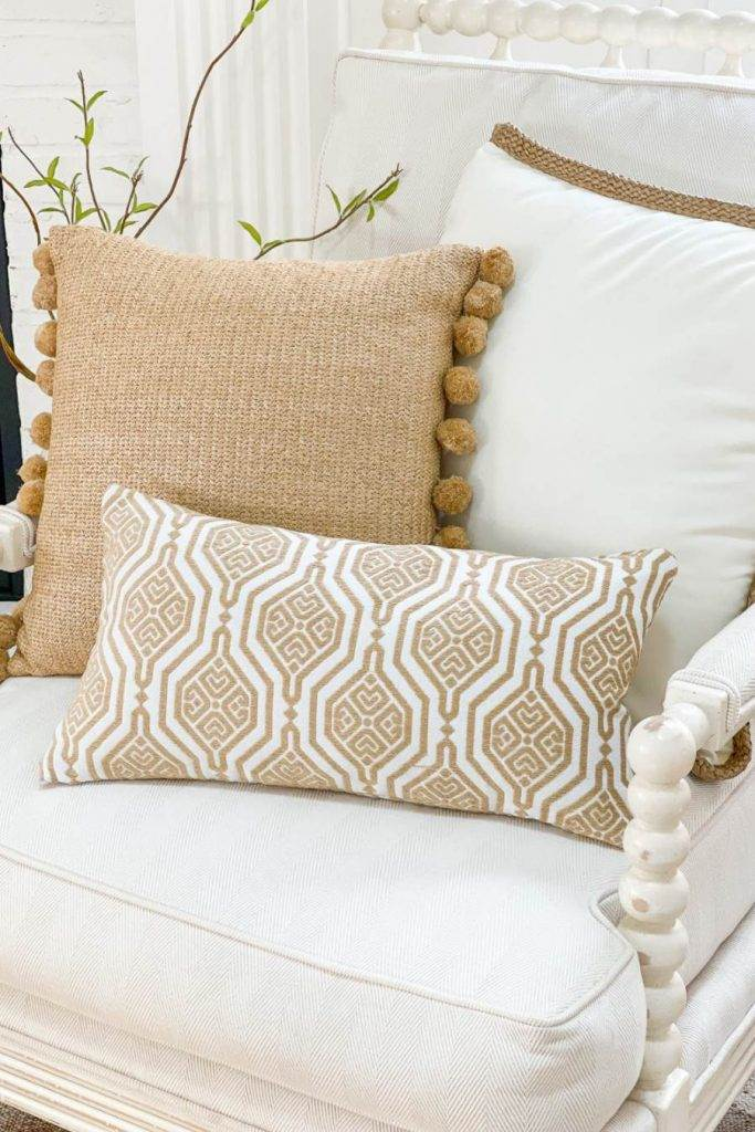 TRIO OF PILLOWS ON A CHAIR