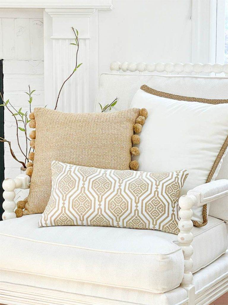 A TRIO OF GOLD AND WHITE PILLOWS