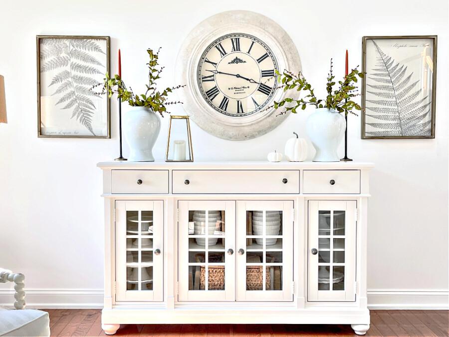 beautiful fall mantel decor on a white buffet
