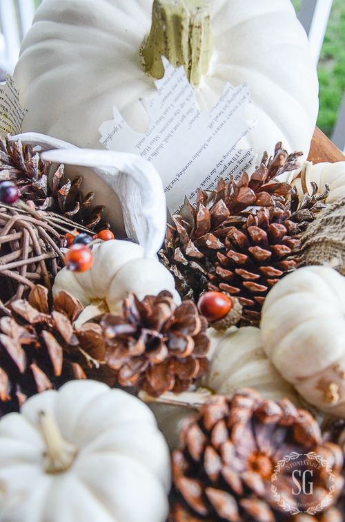 white natural fall dough bowl with pinecones and other organics
