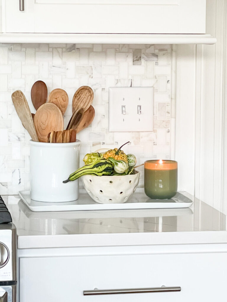 KITCHEN SPOONS AND GOURDS BY THE STOVE