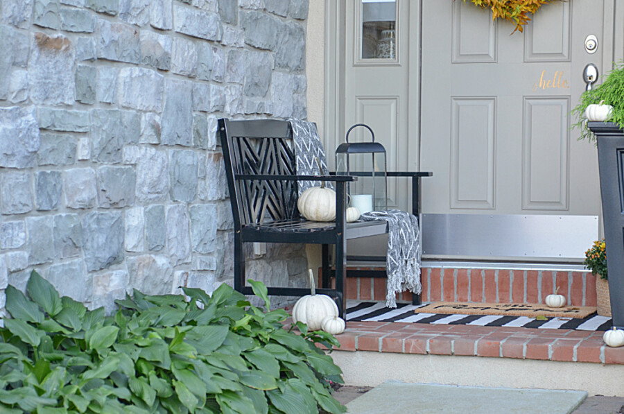 FALL BENCH ON A FRONT PORCH