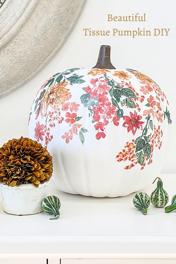 TORN TISSUE PUMPKIN DISPLAYED ON A WHITE TABLE