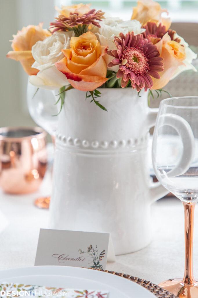 beautiful white vase of fall flowers