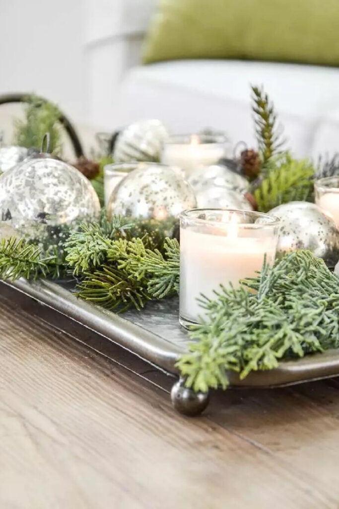 ARRANEGMENT OF GRENS AND CANDLES CHRISTMAS TREND FOR 2021
